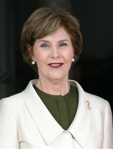 """FILE - In this Nov. 21, 2008, file photo, first lady Laura Bush, left, stands at the presidential palace in Panama City. In her new book, """"Spoken from the Heart,"""" Bush describes being wracked by guilt and losing her faith for many years."""