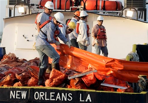 Workers load oil booms onto a crew boat to assist in the containment of oil from a leaking pipeline in the Gulf of Mexico near the coast of Louisiana in Venice, La., Thursday, April 29, 2010.