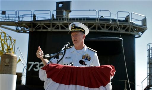 U.S. Navy Rear Admiral Barry Bruner speaks with members of the media in front of the submarine U.S.S Alaska.