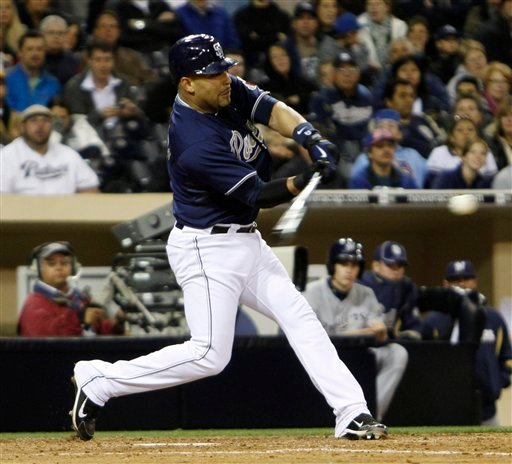 San Diego Padres' Yorvit Torrealba hits a two-run RBI in the fifth inning against the Milwaukee Brewers in a baseball game Thursday April 29, 2010 in San Diego. (AP Photo/Lenny Ignelzi)