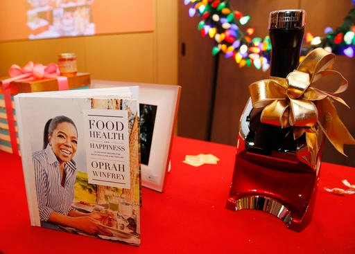 "Oprah Winfrey's ""Food, Health and Happiness,"" a recipe book suggested for Weight Watchers, is displayed among items personally selected for the 2016 Christmas season, at the headquarters of ""O-The Oprah Magazine,"" Tuesday, Nov. 1, 2016, in New York."