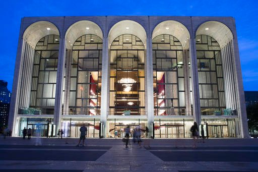 In this Aug. 1, 2014, file photo, pedestrians make their way in front of the Metropolitan Opera house at New York's Lincoln Center.
