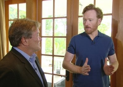 In this image taken from video and released by CBS, former 'Tonight Show' host Conan O'Brien, right, talks with '60 Minutes' correspondent Steve Kroft, at O'Brien's Los Angeles home, Wednesday, April 21, 2010.