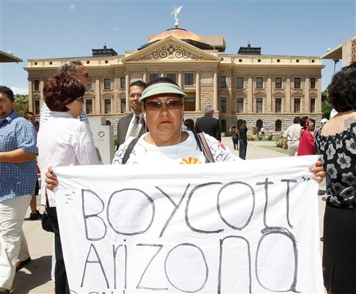 Arizona is facing a backlash over its new law cracking down on illegal immigrants, with opponents pushing for a tourism boycott like the one that was used to punish the state 20 years ago over its refusal to honor the Rev. Martin Luther King Jr. with a ho