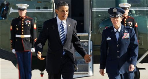 President Barack Obama walks with Jacqueline D. Van Ovost, commander, 89th Airlift Wing, Andrews Air Force Base, towards Air Force One at Andrews Air Force Base. (AP Photo/Charles Dharapak)