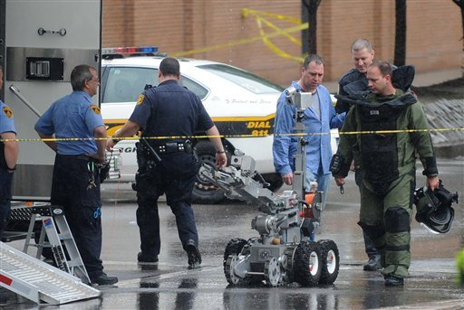 A member of the Pittsburgh Bomb Squad and a robot return after detonating a device outside the Greyhound Transportation Center during the Pittsburgh Marathon Sunday, May 2, 2010. (AP Photo/Tribune-Review, Philip G. Pavely) PITTSBURGH OUT