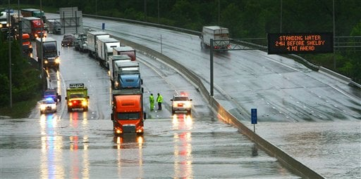 A semi truck tries to drive past the flood waters on Interstate 24 in Saturday, May 1, 2010 in Nashville, Tenn. (AP Photo/The Tennessean, Larry McCormack)