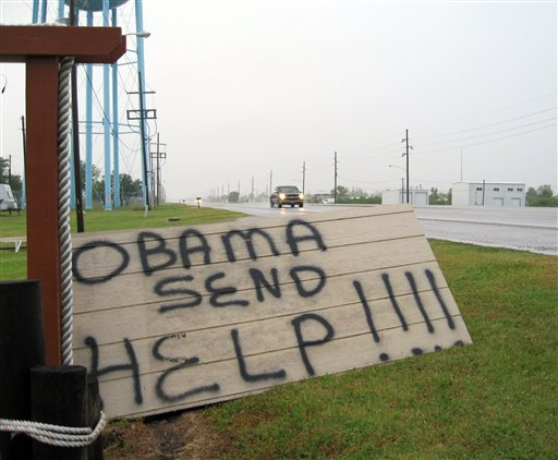 A sign on the side of a road in Boothville, La. is shown Sunday, May 2, 2010. (AP Photo/Allen Breed)