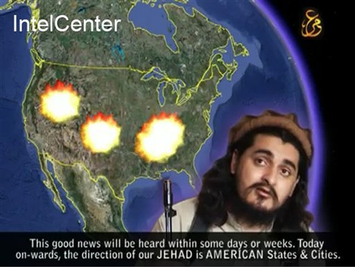 An image from a Pakistani Taliban video and released by IntelCenter, a private contractor working for intelligence agencies, shows Pakistani Taliban chief Hakimullah Mehsud before a map of the United States with explosions on it. (AP Photo/IntelCenter)