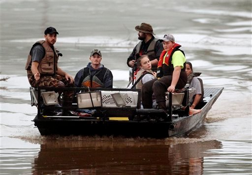 People are brought across flood waters from the Somerset Farms subdivision on Sunday, May 2, 2010, in Nashville, Tenn. Flooding cut off access to Somerset Farms and residents were evacuated. (AP Photo/Mark Humphrey)