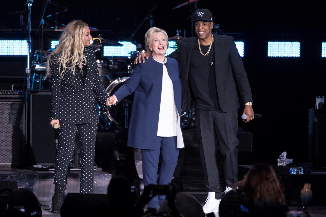 Jay Z, right, and Beyonce, left, stand with Democratic presidential candidate Hillary Clinton during a campaign rally in Cleveland, Friday, Nov. 4, 2016. (AP Photo/Matt Rourke)