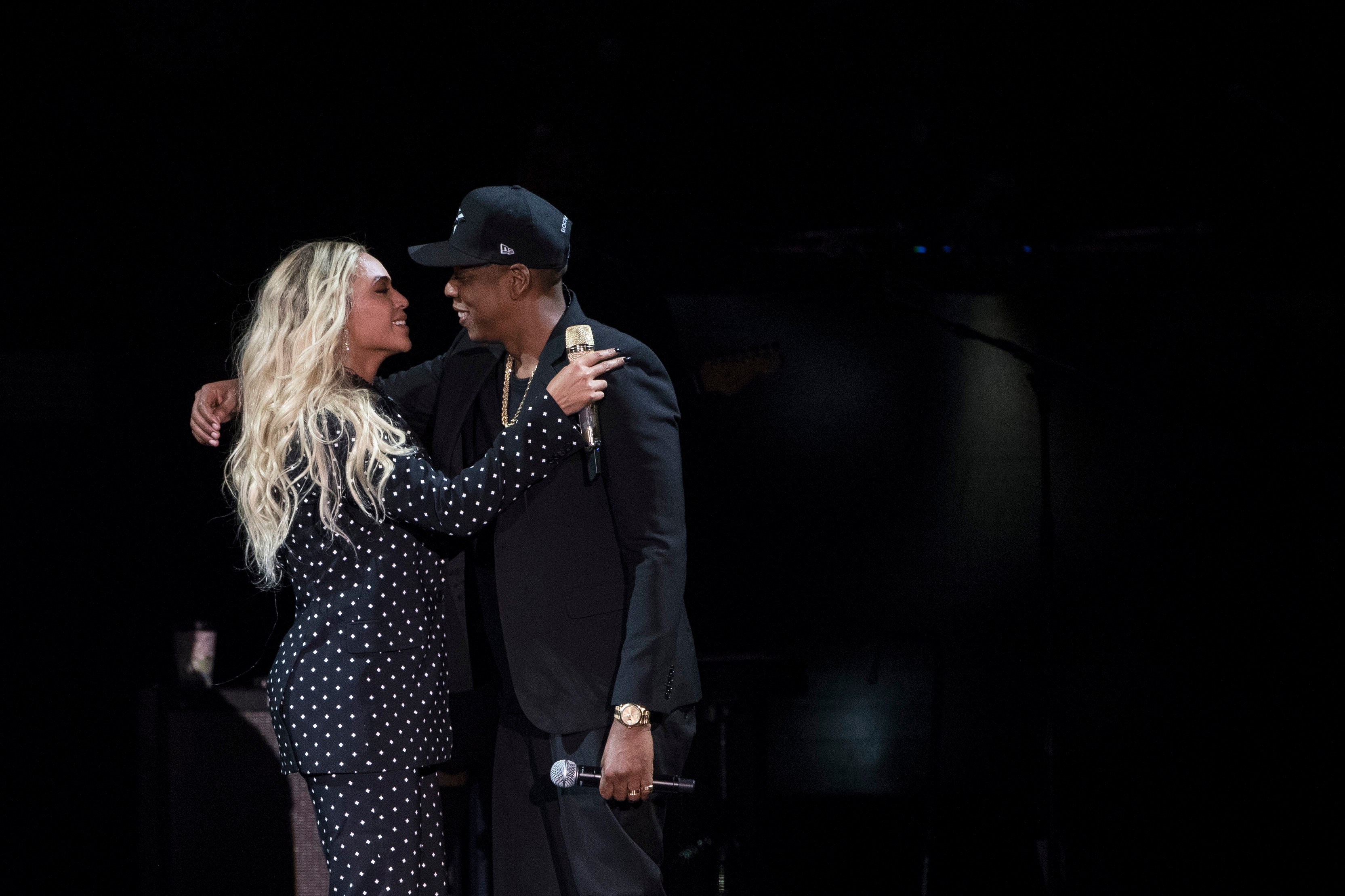 Jay Z and Beyonce embrace during a campaign rally for Democratic presidential candidate, Hillary Clinton, in Cleveland, Friday, Nov. 4, 2016. Clinton's campaign is turning to a series of star-studded free concerts in swing states to try and energize young