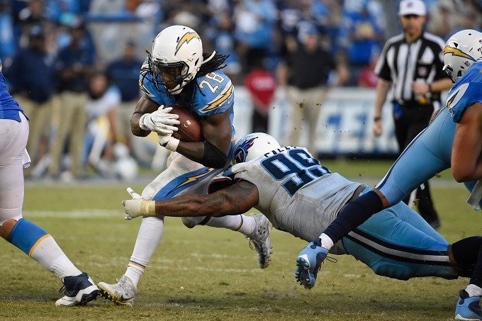San Diego Chargers running back Melvin Gordon gets past Tennessee Titans defensive end Jurrell Casey during the second half of an NFL football game Sunday, Nov. 6, 2016, in San Diego. (AP Photo/Denis Poroy)