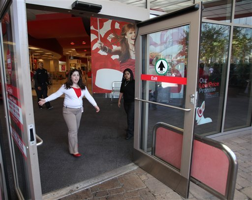 An unidentified Target security employee keeps the media away from the front door, after a woman was arrested after at least four people were stabbed, with one critically wounded inside the store in West Hollywood, Calif. on Monday, May 3, 2010 (AP Photo)
