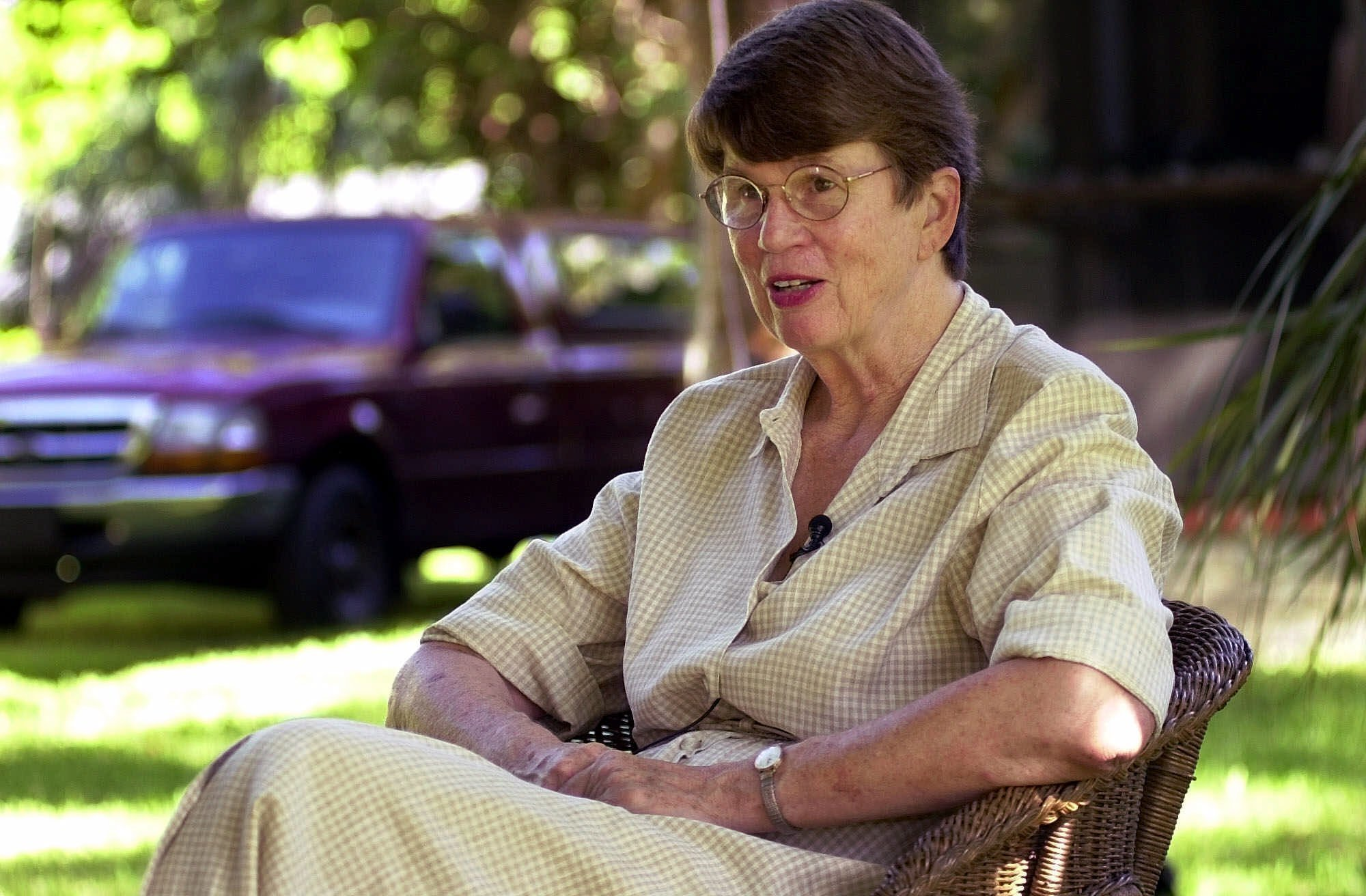 Sept. 4, 2001, file photo: Former U.S. Attorney General Janet Reno speaks with members of the media from the backyard of her home, in Miami, after announcing that she would be running for Governor of Florida. (AP Photo/Tony Gutierrez, File)