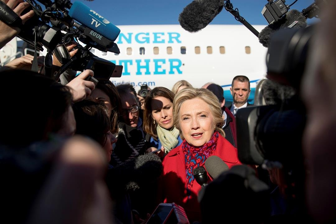 Democratic presidential candidate Hillary Clinton speaks to members of the media before boarding her campaign plane at Westchester County Airport in White Plains, N.Y., Nov. 7, 2016, to travel to Pittsburgh. (AP Photo/Andrew Harnik)