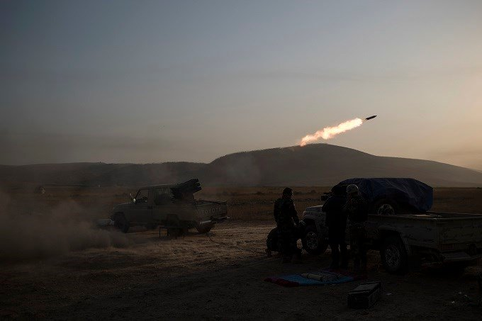 Kurdish Peshmerga soldiers fire artillery at Islamic State positions in Bashiqa, east of Mosul, Iraq, Monday, Nov. 7, 2016. Iraqi Kurdish fighters are exchanging heavy fighters with militants as they advance from two directions on a town held by the Islam
