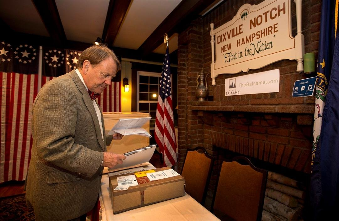 Town moderator Tom Tillotson arrives with ballots Monday, Nov. 7, 2016, as voters in Dixville Notch, get ready to cast their votes at mid-night in Dixville Notch, N.H. (AP Photo/Jim Cole)