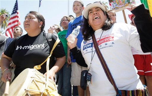 Rosamaria Soto, right, of Phoenix, and Kimberly Mendoza, of Los Angeles, join thousands of protesters as they attend a rally at the Arizona Capitol on Sunday, April, 25, 2010. (AP Photo/Ross D. Franklin)