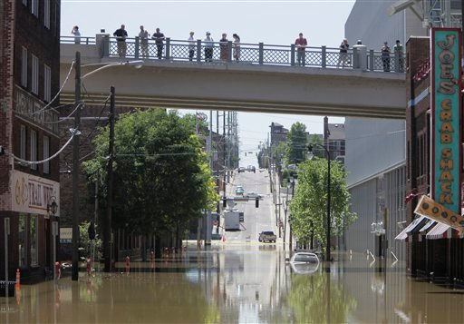 Pedestrians survey flooded streets as the waters of the Cumberland River slowly started to ebb , Tuesday, May 4, 2010, in Nashville, Tenn. The river and its tributaries had flooded parts of middle Tennessee after a record-breaking weekend storm.