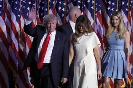 President-elect Donald Trump waves as he walks with his wife Melania Trump followed by his daughter Ivanka Trump after giving his acceptance speech.