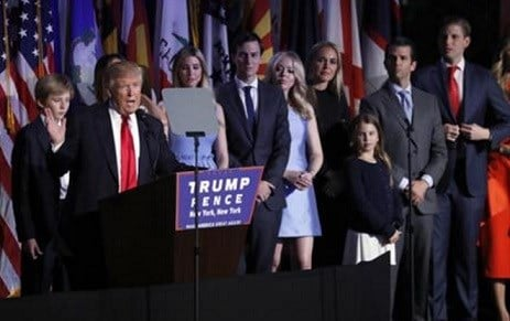 President-elect Donald Trump gives his acceptance speech as he is surrounded by his family arrives at his election night rally, Wednesday, Nov. 9, 2016, in New York.