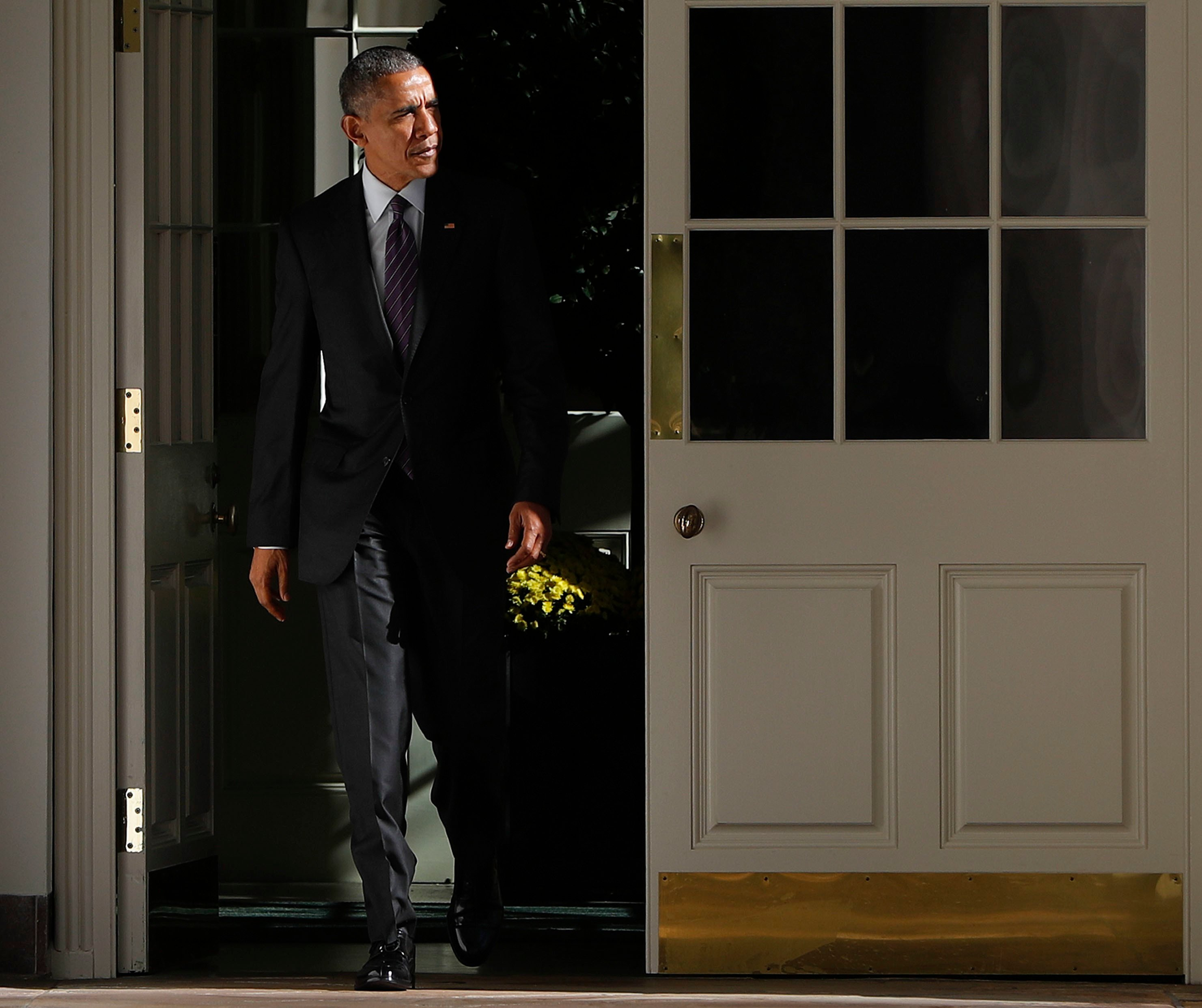 President Barack Obama walks out of the main residence of the White House and down the Colonnade and heads towards the Oval Office, Tuesday, Nov. 8, 2016, in Washington. (AP Photo/Pablo Martinez Monsivais)