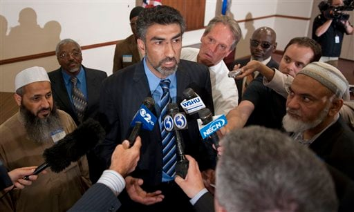 Mongi Dhaouadi, center, executive director of Connecticut chapter of the Council of American-Islamic Relations, talks to the media before the start of an interfaith meeting in Bridgeport, Conn. Wednesday May 5, 2010. (AP Photo/Douglas Healey)