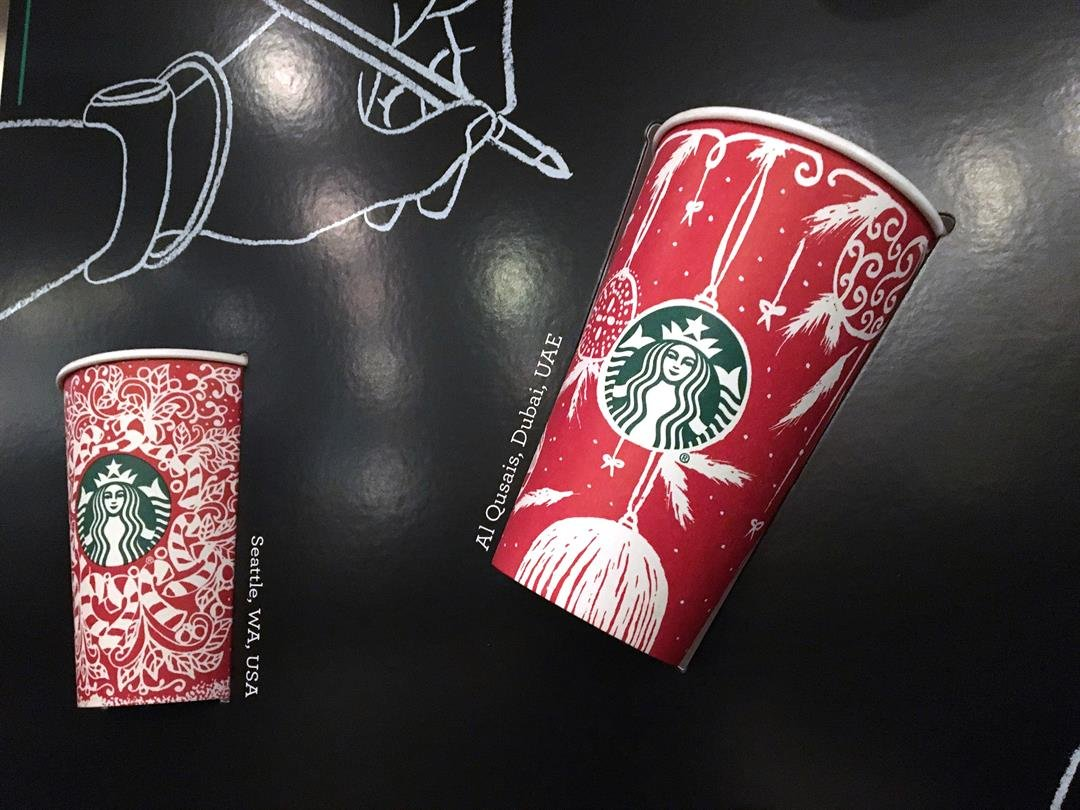 Snowflakes, reindeer and candy canes are back on Starbucks holiday coffee cups, after last year's plain red cups caused uproar from critics who said the chain was part of a so-called war on Christmas. (AP Photo/Joseph Pisani)