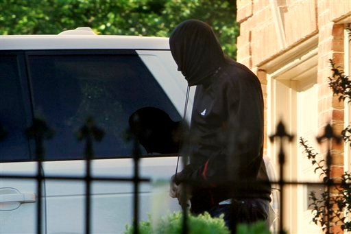 Washington Wizards basketball player Gilbert Arenas pulls the strings of a sweatshirt tight to obscure his face after arriving at his home in Great Falls, Va., on Friday, May 7, 2010, after being released from a halfway house. (AP Photo/Jacquelyn Martin).