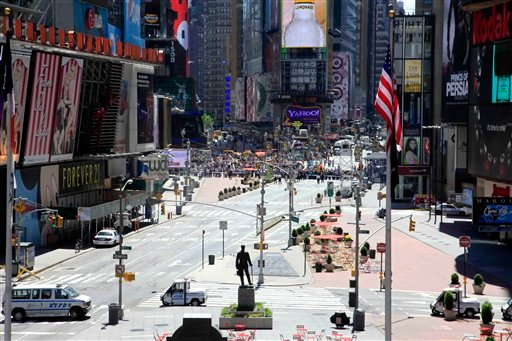 Authorities clear streets around New York's Times Square and called in the bomb squad Friday, May 7, 2010, after finding a cooler left on a sidewalk a block away from where where a failed car bomb was found over the weekend. (AP Photo/Mark Lennihan)