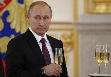 Russian President Vladimir Putin makes a toast during a ceremony for receiving diplomatic credentials from foreign ambassadors in the Kremlin in Moscow, Russia.