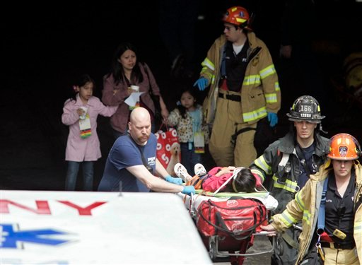 Emergency personnel transport a victim to an awaiting ambulance in the Staten Island Ferry terminal in Staten Island, New York, Saturday, May 8, 2010, after a ferry boat crashed into the dock. (AP Photo/Robert Mecea)