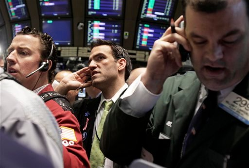 In this May 7, 2010, file photo traders work on the floor of the New York Stock Exchange in New York.   (AP Photo/Richard Drew, File)