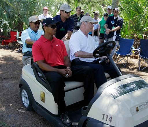 Tiger Woods is driven off the course after a neck injury on the 7th hole during the final round of The Players Championship golf tournament Sunday, May 9, 2010, in Ponte Vedra Beach, Fla. (AP Photo/Chris O'Meara)