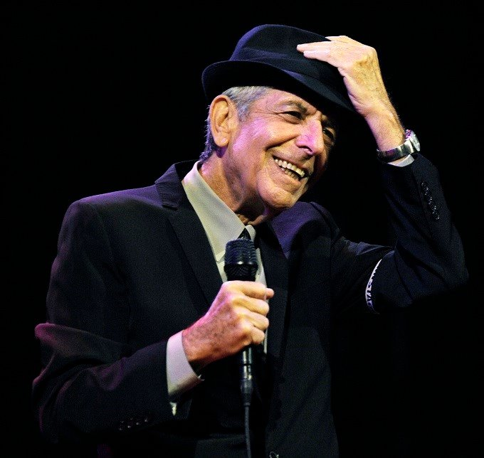 "In this April 17, 2009, file photo, Leonard Cohen performs during the first day of the Coachella Valley Music & Arts Festival in Indio, Calif. Cohen, the gravelly-voiced Canadian singer-songwriter of hits like ""Hallelujah,"" ""Suzanne"" and ""Bird on a Wire,"""