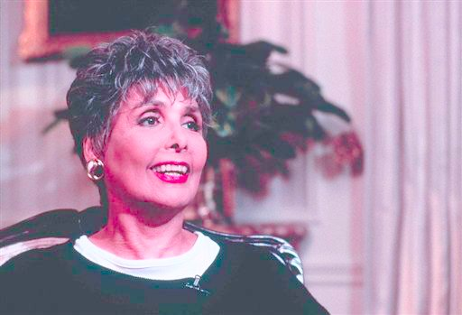 "FILE -- This is a June 1995 file portrait of singer and actress Lena Horne. Singer Lena Horne, who broke racial barriers as a Hollywood and Broadway star famed for her velvety rendition of ""Stormy Weather,"" has died at age 92. (AP Photo/File)"