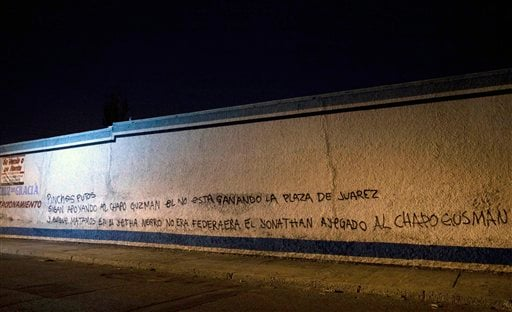 "Graffiti, allegedly signed by members of the Juarez drug cartel, is seen on a wall in Ciudad Juarez late Sunday April 11, 2010. The message says that Joaquin ""El Chapo"" Guzman is not in control of Juarez and claims the murder of one of a supporter. (AP)"