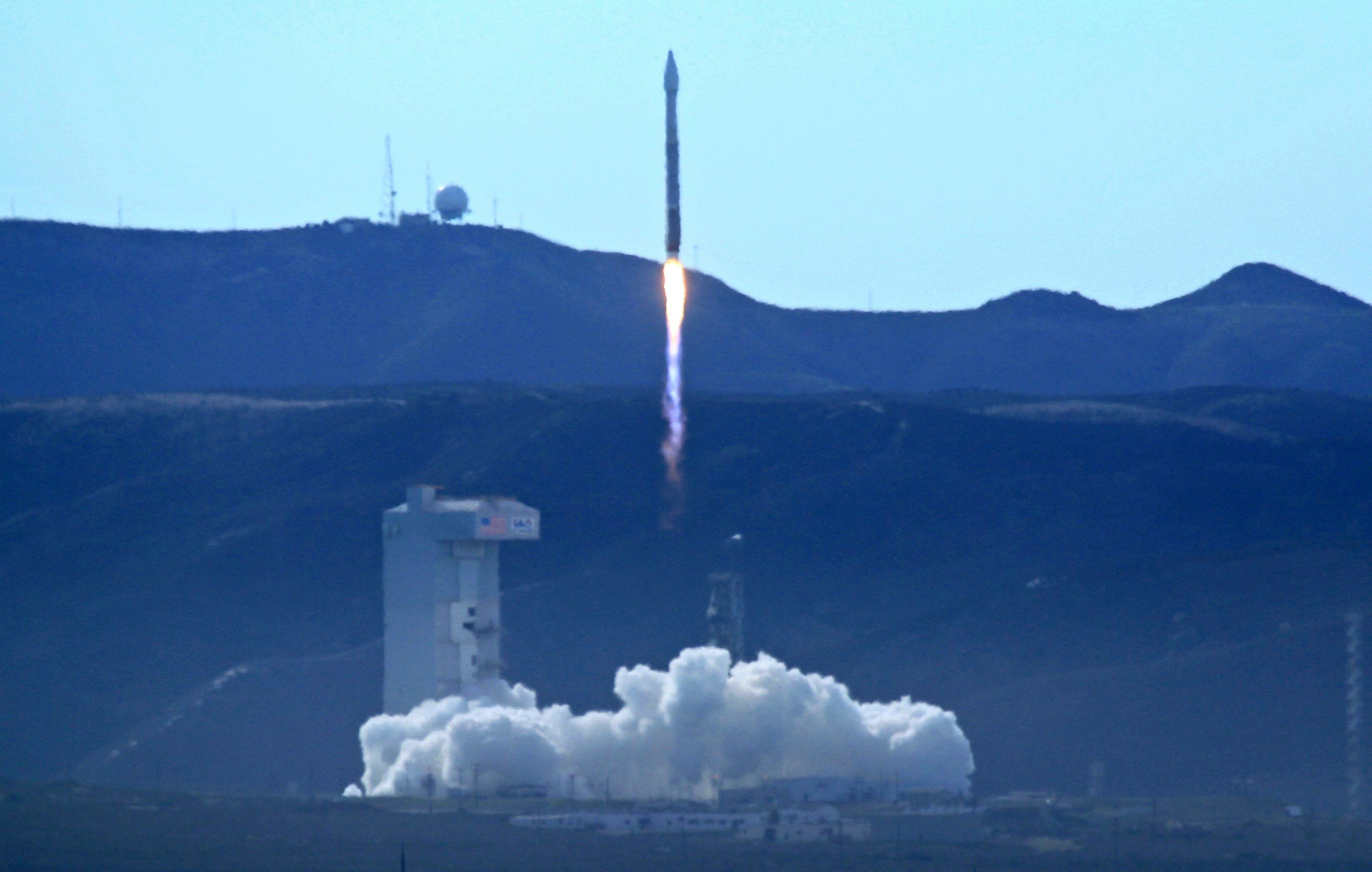 The satellite is designed to produce high-resolution images of Earth from space. (Matt Hartman via AP)