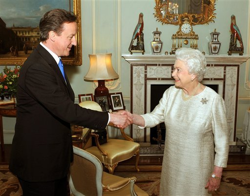 Britain's Queen Elizabeth II greets David Cameron, the leader of the Conservative Party, at Buckingham Palace, London, in an audience to invite him to be the next Prime Minister of the United Kingdom. (AP Photo/John Stillwell, Pool)