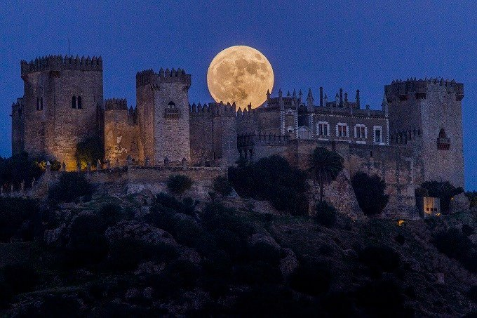 The moon rises behind the castle of Almodovar in Cordoba, southern Spain, on Sunday, Nov. 13, 2016. The Supermoon on November 14, 2016, will be the closest a full moon has been to Earth since January 26, 1948. (AP Photo/Miguel Morenatti)