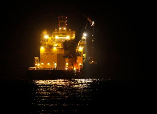 The Viking Poseidon lowers the top hat device at the site of the Deepwater Horizon oil spill in the Gulf of Mexico off the coast of Louisiana Tuesday, May 11, 2010. (AP Photo/Gerald Herbert, Pool)