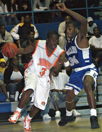 In this photo made Feb. 4, 2006, Boyd Anderson's Martavious Irving, left, drives against Dillard's Guerdwich Montimere during a basketball game at Fort Lauderdale High School in Fort Lauderdale, Fla.