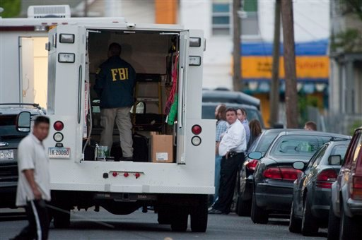 An FBI agent stands inside a truck outside a home in Bridgeport, Conn. Tuesday morning May 4, 2010. FBI searched a home in Bridgeport where Faisal Shahzad lived. Shahzad was arrested in connection with the failed Times Square car bomb. (AP Photo/Douglas H
