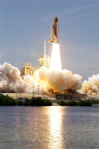 Space shuttle Atlantis lifts-off from the Kennedy Space Center at Cape Canaveral, Fla. Friday May 14, 2010. Atlantis' 12-day mission will deliver a Russian built storage and docking module to the International Space Station. (AP Photo/Chris O'Meara)