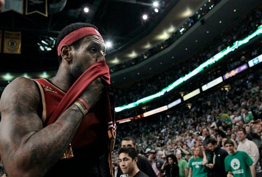 Cleveland Cavaliers forward LeBron James walks off the court after losing to the Boston Celtics in Game 6 in a second-round NBA basketball playoff series in Boston Thursday, May 13, 2010. The Celtics won 94-85. (AP Photo/Elise Amendola)