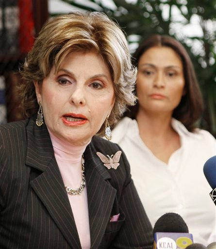 Attorney Gloria Allred speaks for her client, British actress Charlotte Lewis, background right, during a news conference in Los Angeles Friday, May 14, 2010. Lewis alleges that director Roman Polanski sexually victimized her in Paris when she was 16.