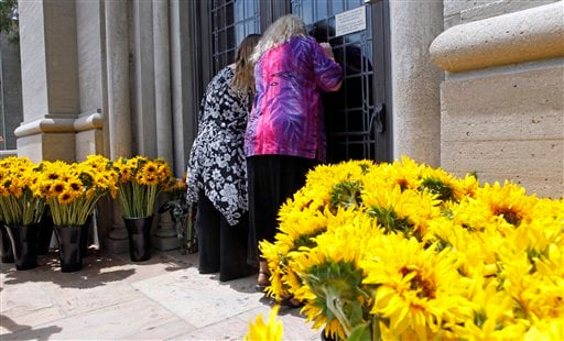 Grower Jason Levin of San Diego on Friday delivered a truckload of sunflowers saying he decided to donate the flowers after hearing Lisa Marie Presley say there were only a few bouquets, candles and gifts surrounding the tomb.