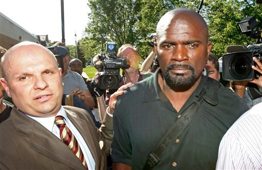In this May 6, 2010, file photo, Pro Football Hall of Famer Lawrence Taylor, right, and his attorney Arthur Idala, left, leave the Ramapo Police Department. (AP Photo/Kathy Willens, File)
