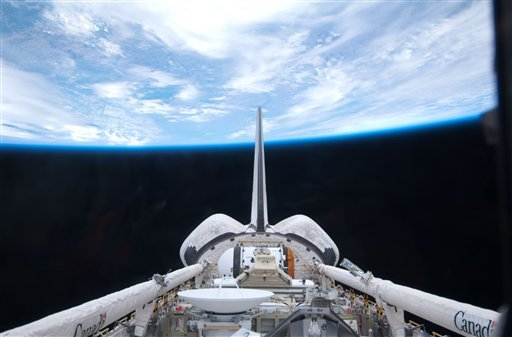 In this image provided by NASA space shuttle Atlantis' cargo bay and its vertical stabilizer intersecting Earth's horizon was provided on Saturday May 15, 2010 by one of the six STS-132 crew members. (AP Photo/NASA)